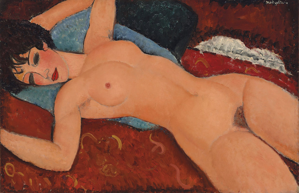 """FILE - This undated image provided by Christie's shows the painting """"Reclining Nude,"""" created in 1917 to 1918 by Amedeo Modigliani, that caused a scandal nearly a century ago. The painting is going on the auction block and will be the highlight of Christie's Monday, Nov. 9, 2015, sale in New York. (Courtesy of Christie's Images via AP, File)"""